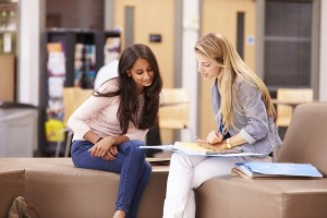 Female College Student Working With Mentor